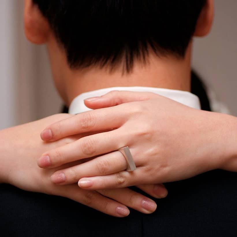 Brushed Silver Wedding Ring on bride finger